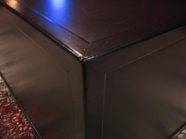 Subwoofer cabinet showing edge moldings